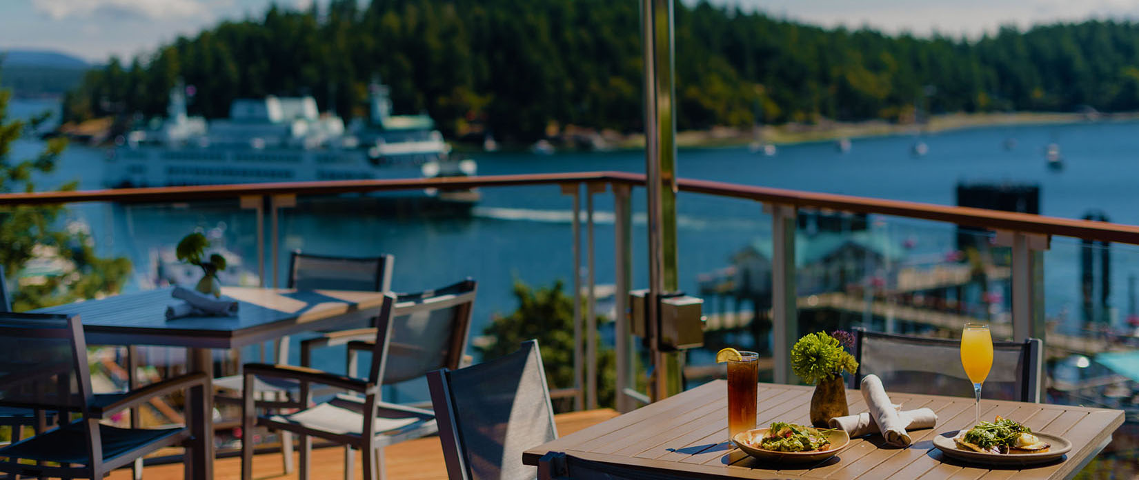 Outdoor dining with harbor view